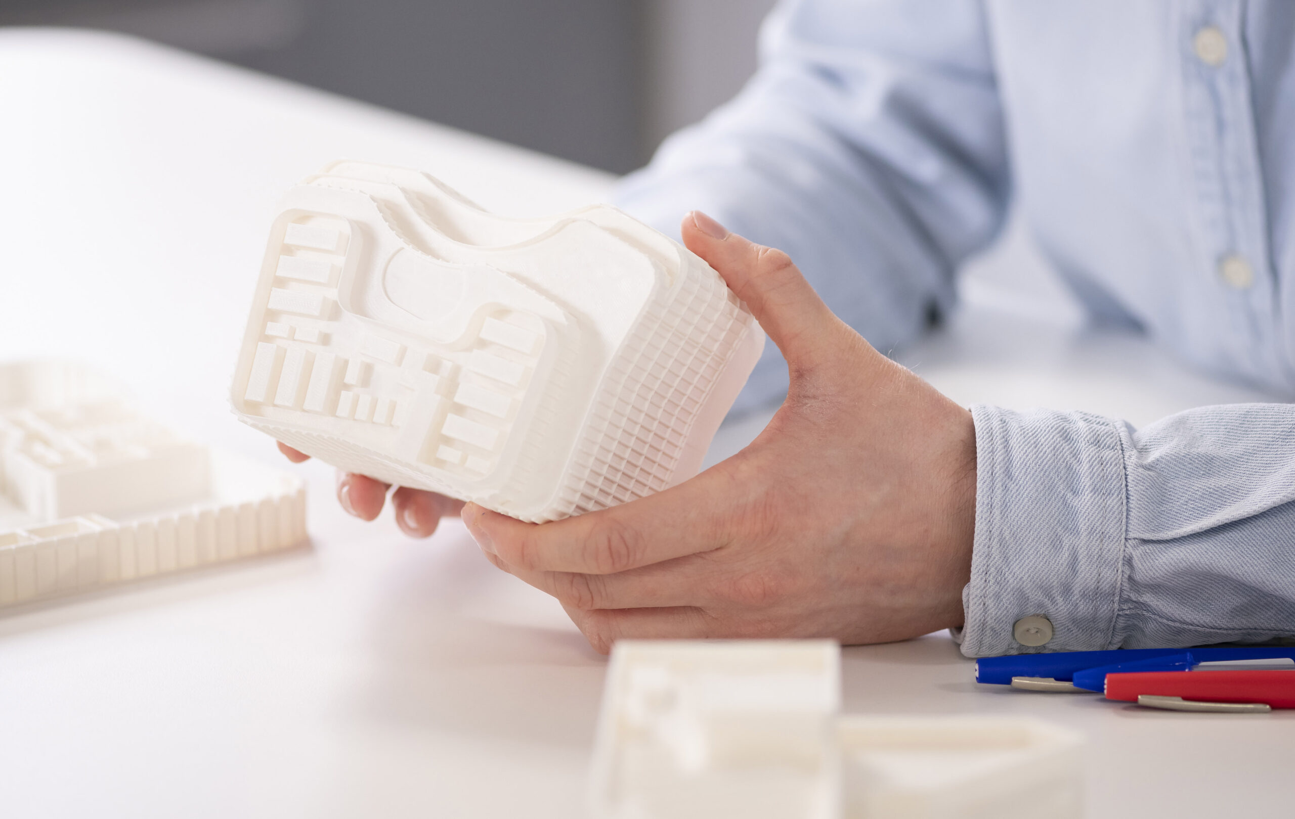 Staff holding a 3D printed model
