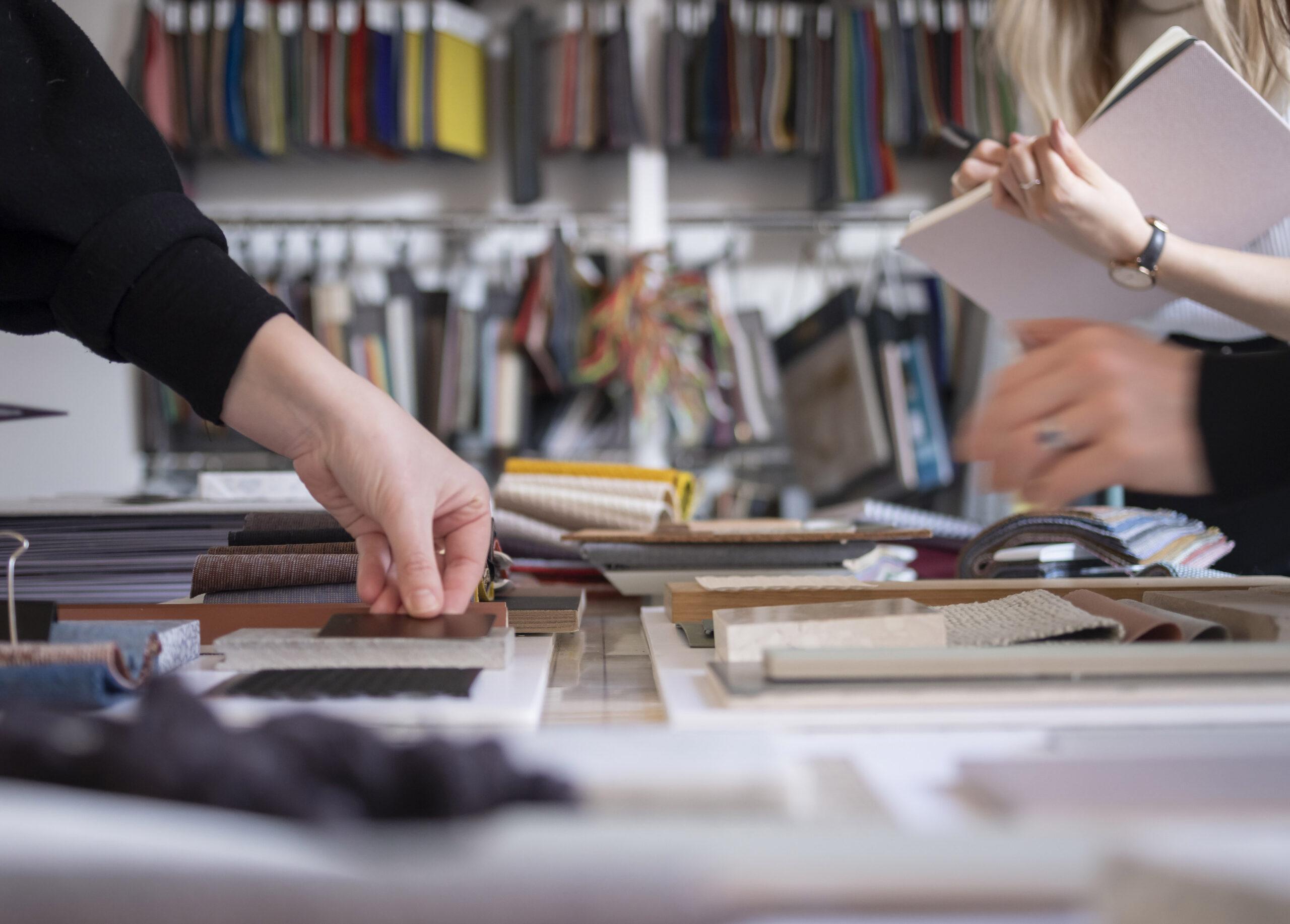 Close up of hands organising interiors samples