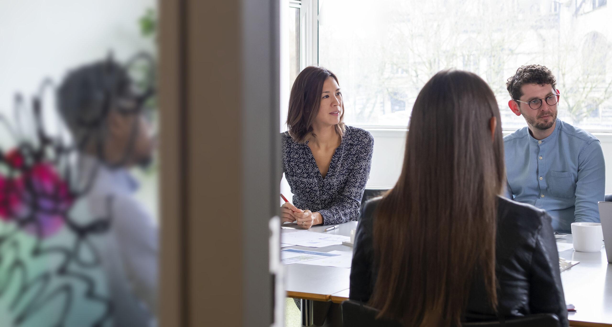 Team meeting sitting around boardroom table